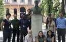Wildlife and aquatic disease lab active in recent conferences--slider image depicts Wildlife and aquatic disease lab posing with bust of József Marek