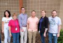 Text reads: Dr. Cuong Nguyen offers expert insight on Sjögren's syndrome. Rheumatology Advisor talks with Dr. Nguyen about the underlying mechanism of the auto-immune condition Sjögren's syndrome. Image caption: Dr. Nguyen's Lab. Image: Six members of Dr. Nguyen's lab poses for a group photo.