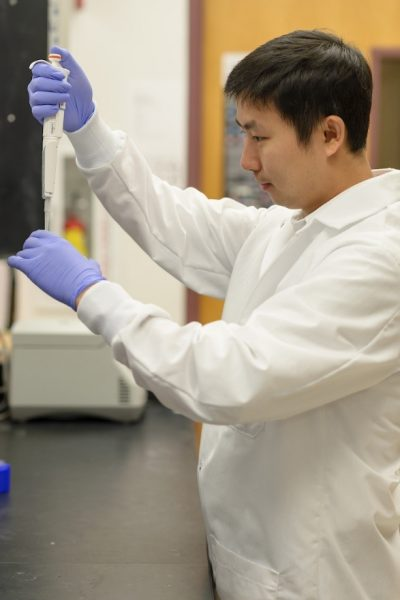 Jian Ye uses a pipette