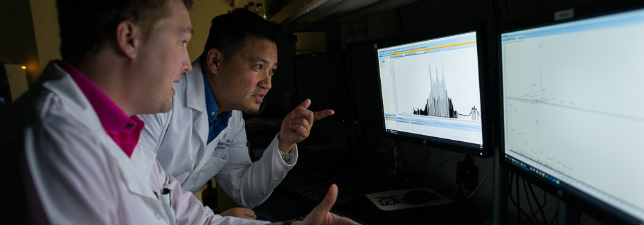Rhoel Dinglasan and his postdoctoral fellow Tim Hamerly discuss proteomic data from a recent study at the EPI. Dinglasan and Hamerly's academic home spans between the EPI and UF's College of Veterinary Medicine's department of infectious diseases and immunology.